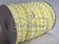 Цветок-бусинка на нитке VX18, св.желтая